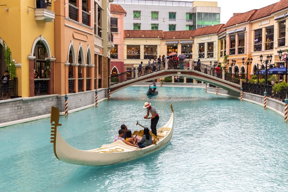 a family enjoying the gondola ride in venice grand canal mall