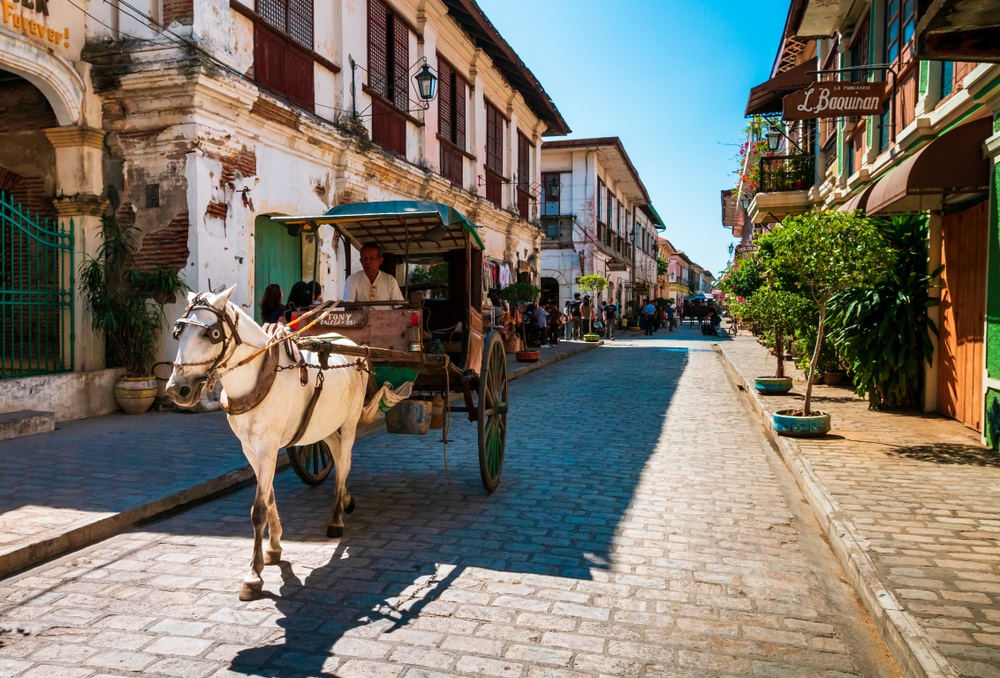 a kalesa passing through the cobblestone streets of vigan